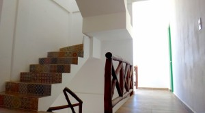 Corridor 1st floor leading to the private room and balcon and stairs leading to the roof-top terrace